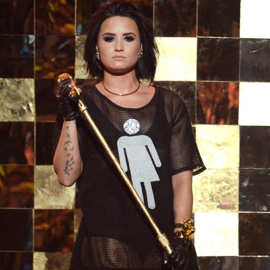 Demi Lovato Wearing Gender Neutral Bathroom Shirt on Stage
