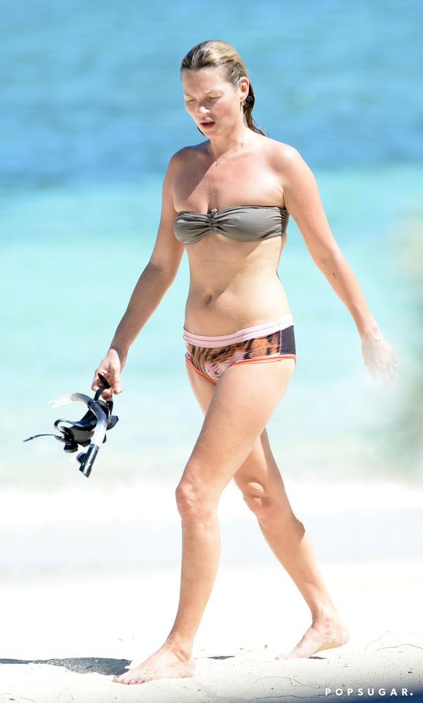 Kate Moss walked on the white sand.