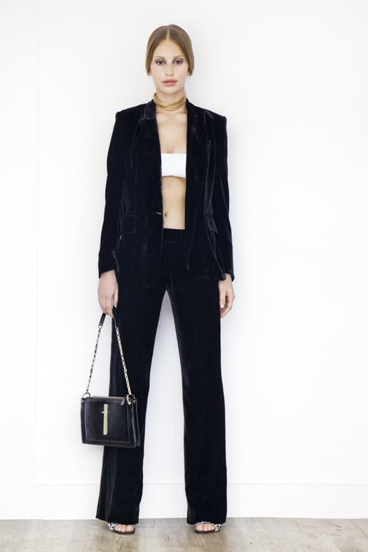 Leather Bandeau in Cream ($350), Classic Velvet Blazer Jacket in Black ($995), Classic Velvet Trouser in Black ($795), Wild Night Pony Sandal in Grey Leopard ($750), Attraction Patent Shoulder Bag in Black ($1,795) Photo courtesy of Tamara Mellon