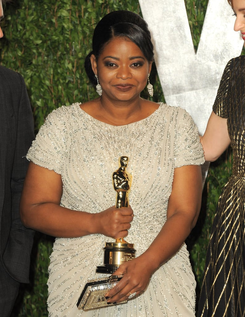Octavia holds on to her Oscar tightly.