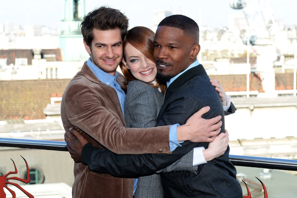 On Wednesday, Andrew Garfield and Jamie Foxx gave Emma Stone a hug while promoting The Amazing Spider-Man 2 in London.