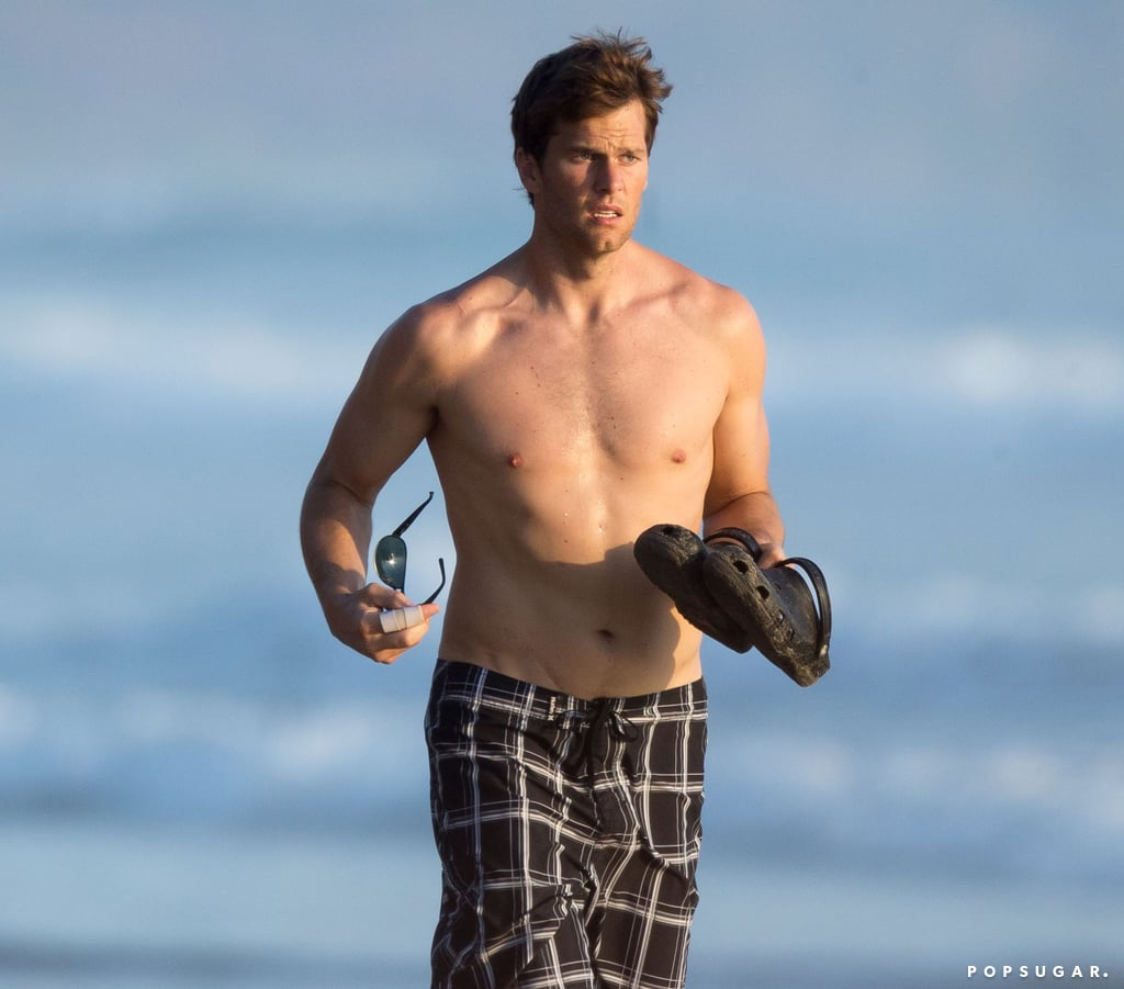 Tom Brady ran shirtless on the beach.