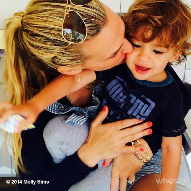 Molly Sims kicked off Brooks Stuber's birthday week with a kiss. Source: Instagram user mollybsims