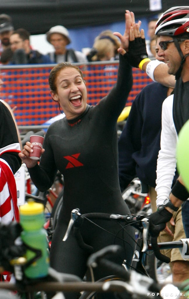 In September 2008, Jennifer Lopez happily gave a pal a big clap during the Malibu Triathlon.
