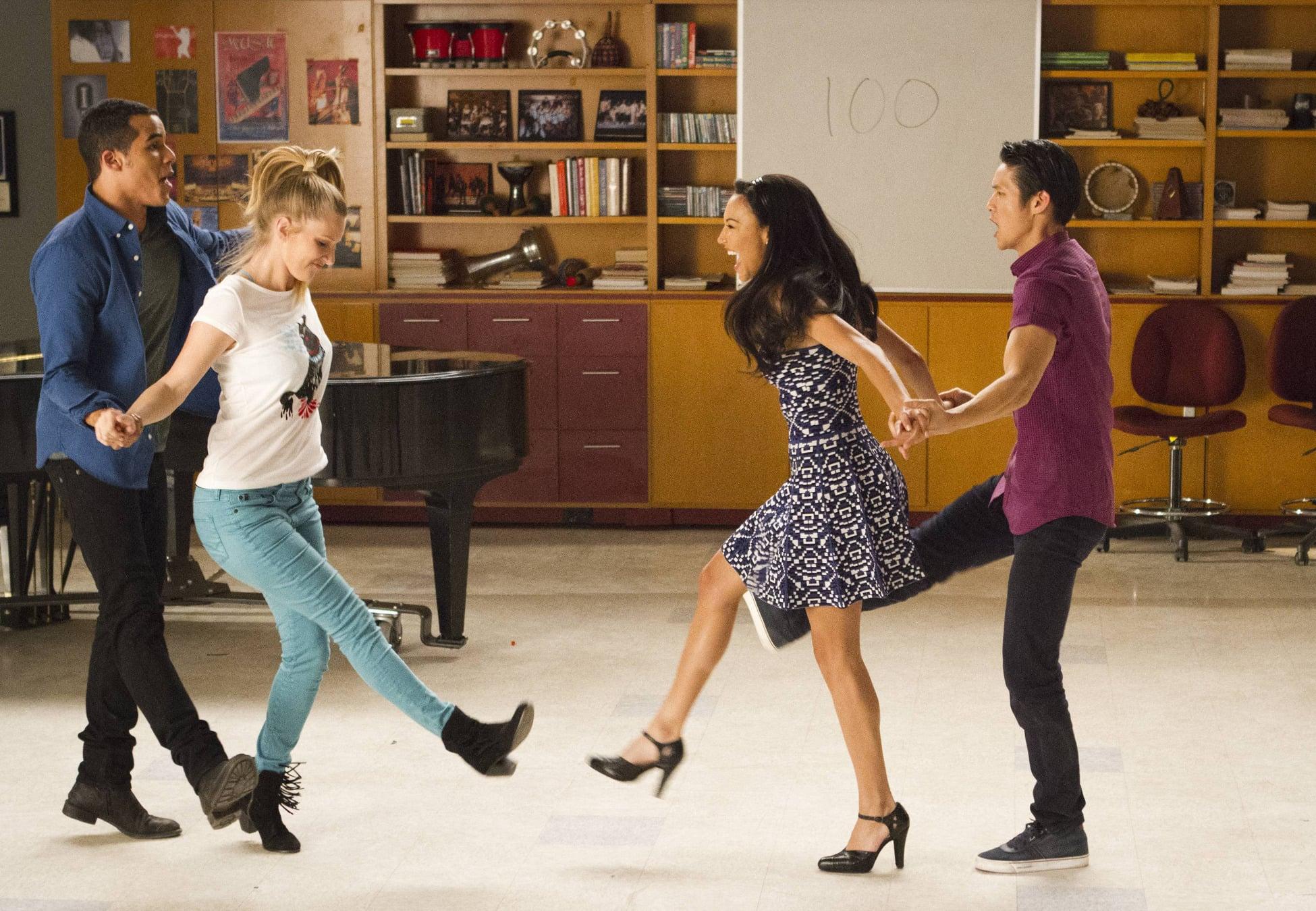 "Jake (Jacob Artist), Brittany (Heather Morris), Santana (Naya Rivera), and Mike (Harry Shum Jr.) perform on the ""100"" episode of Glee."