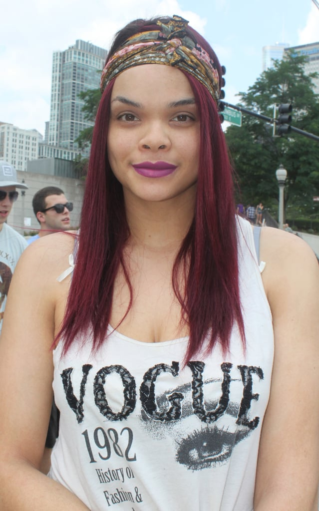In addition to the stylish Vogue tank, the purple hair color and lipstick duet drew us to Lolla attendee Stacy.