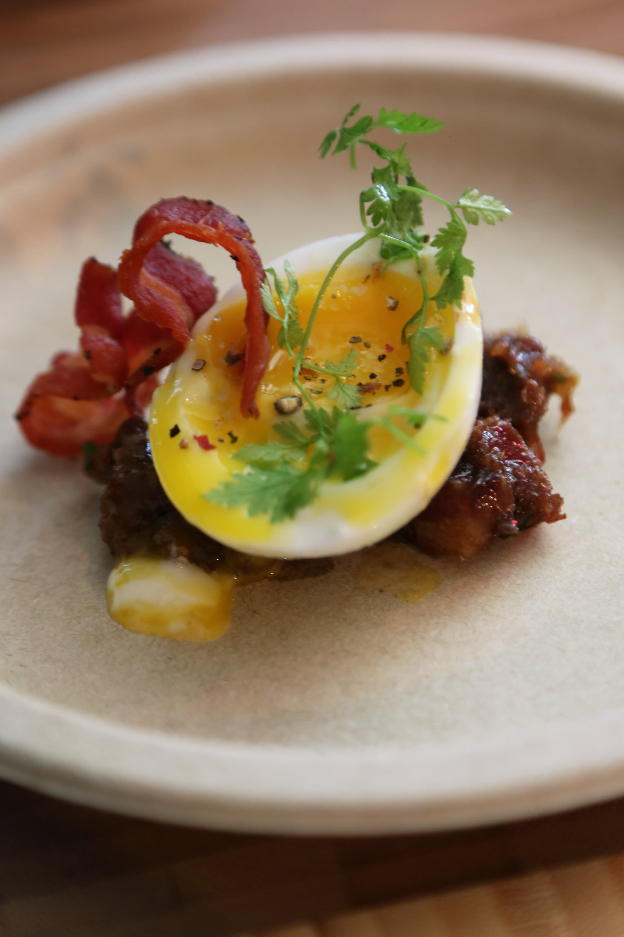 Do: Top It With an Egg (and Bacon)