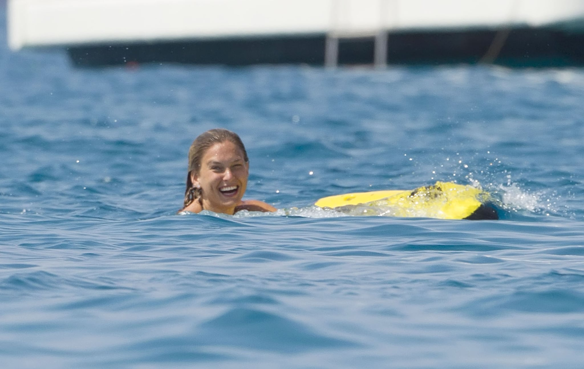 Bar Refaeli flashed a smile in the water.