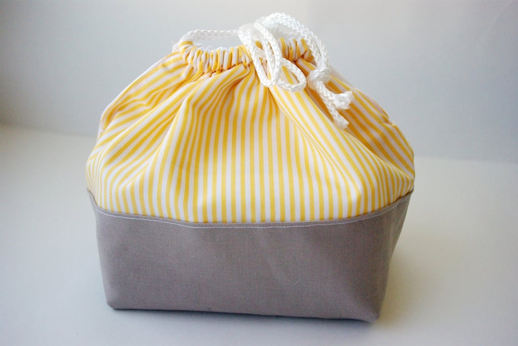 Any old Tupperware can still look chic wrapped up in a pert cloth lunch carrier ($21). We love the of-the-moment yellow and grey color scheme.