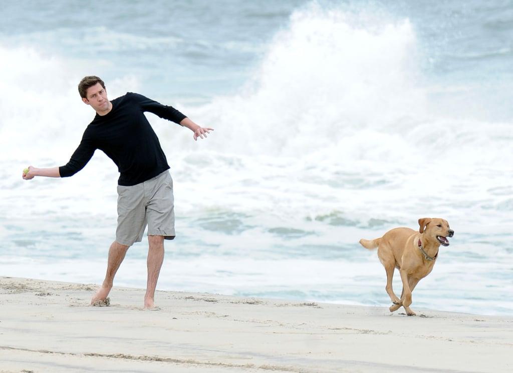John Krasinski's faithful companion, Finn, played fetch with him on the beach in the Hamptons in May 2010.