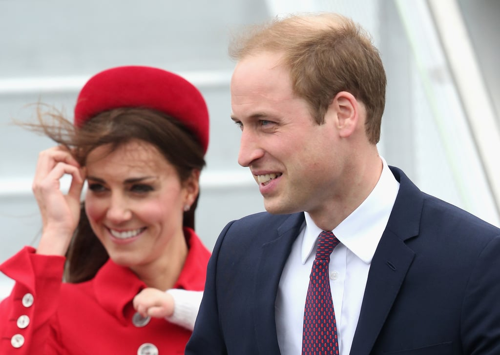 Kate tried to keep her hair in place during a windy arrival to Wellington on April 7.