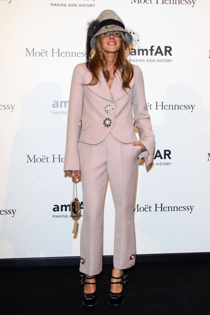 Anna Dello Russo traded her thigh-high hemline for a more conservative, albeit whimsical, suit at amfAR.