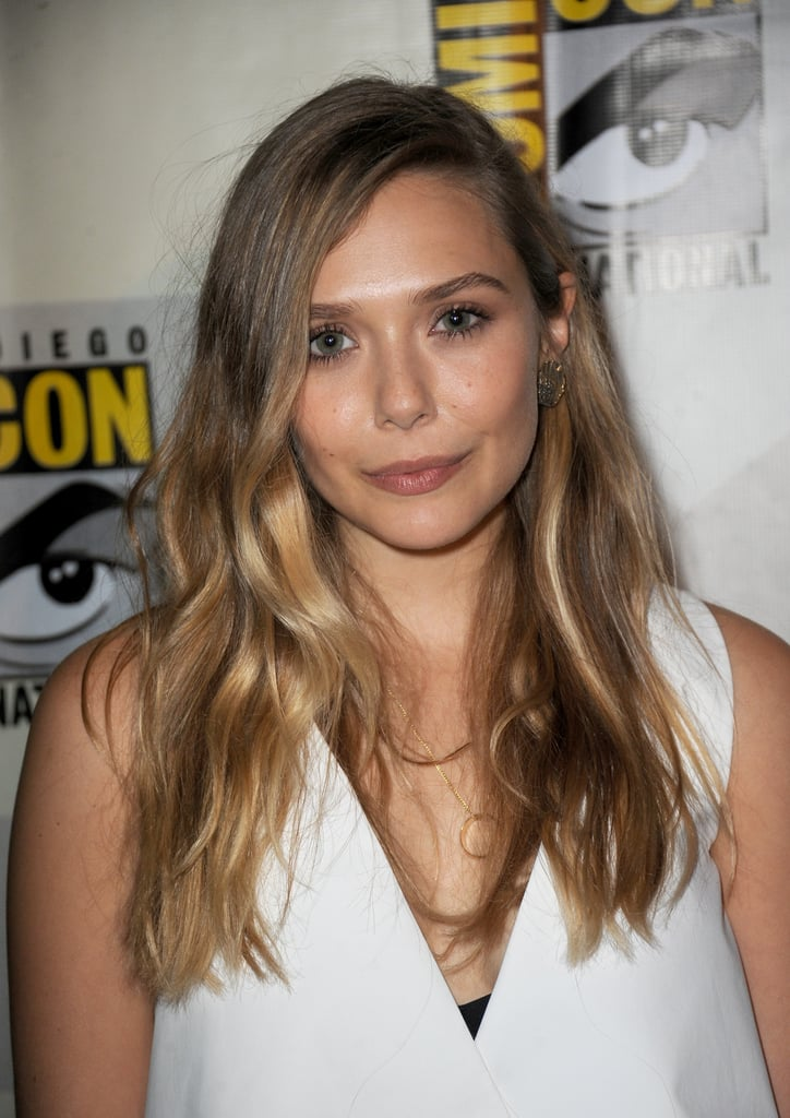 Elizabeth Olsen chose bold brows, nude lips, and cool-girl bedhead waves for her appearance at Comic-Con.