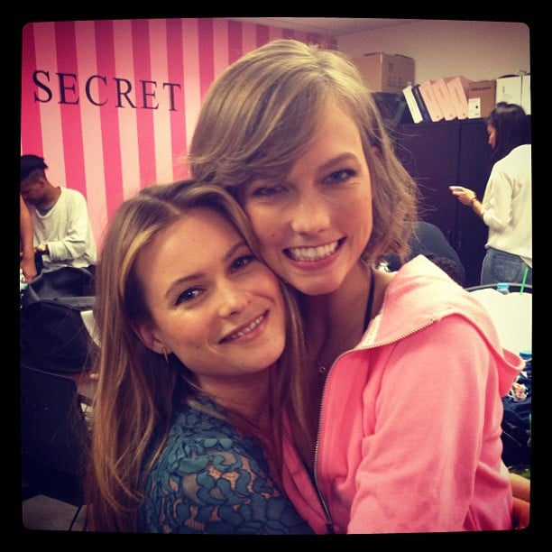 Karlie Kloss snuggled up to her newly engaged fellow Angel Behati Prinsloo during a Victoria's Secret promo event. Source: Instagram user victoriassecret