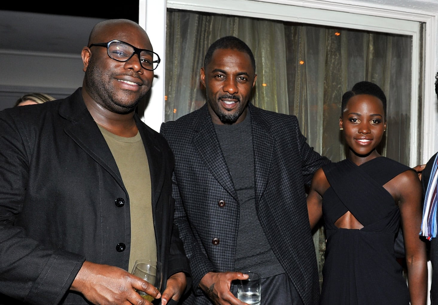 Director Steve McQueen mingled with his 12 Years a Slave stars Idris Elba and Lupita Nyong'o.