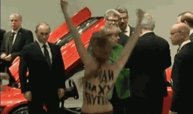 Putin Gives Topless Protester Two Thumbs Up