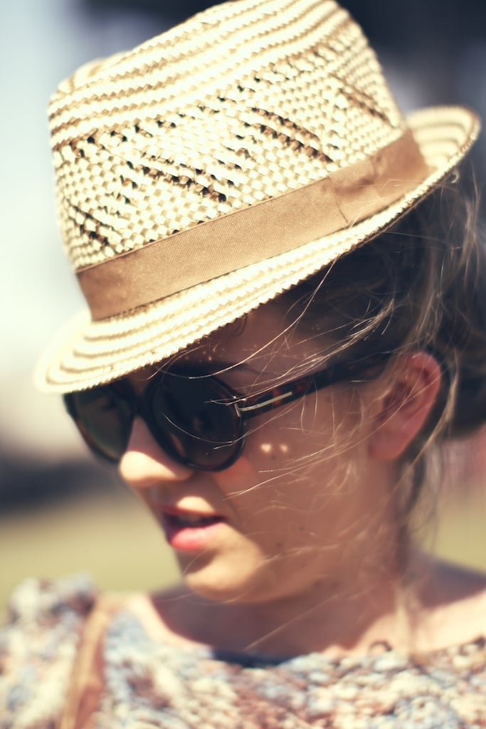 A cool woven hat and round sunglasses add a retro vibe to this festival ensemble.