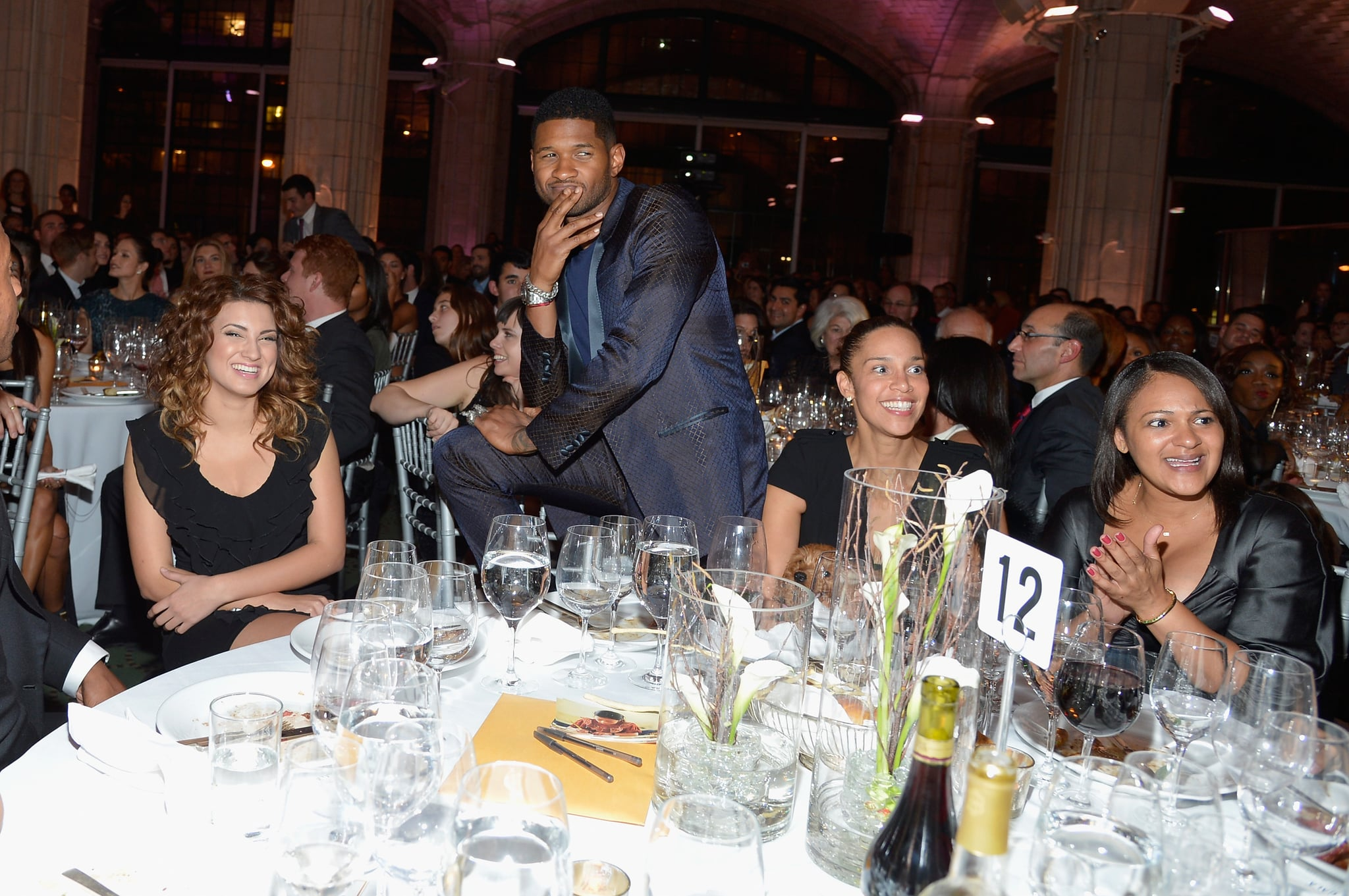 Usher struck a pose in the audience.