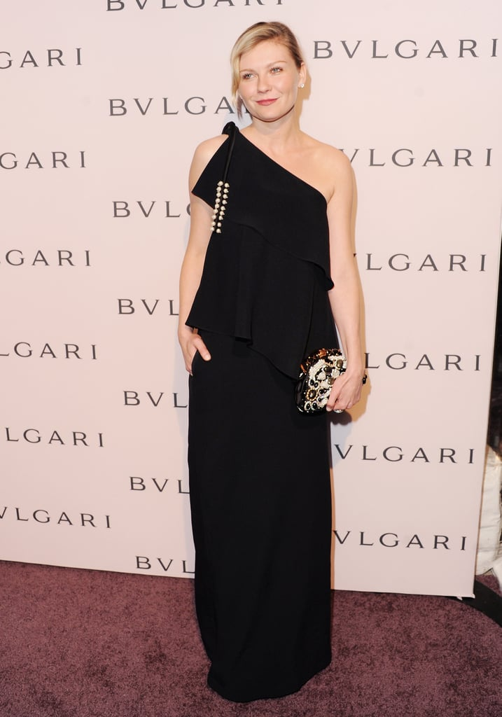 Kirsten Dunst channelled Old Hollywood glamour in a black one-shouldered Chloé gown paired with a beaded clutch.