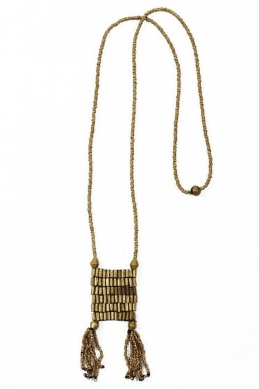 This tribal-infused statement necklace was crafted from gold beaded macramé and handmade from melted bullet casings and recycled metals by HIV-positive women in Ethiopia. The proceeds fund health care and literacy programs for women and children in this community.  Amleset: Macramé Tassel Necklace ($88)