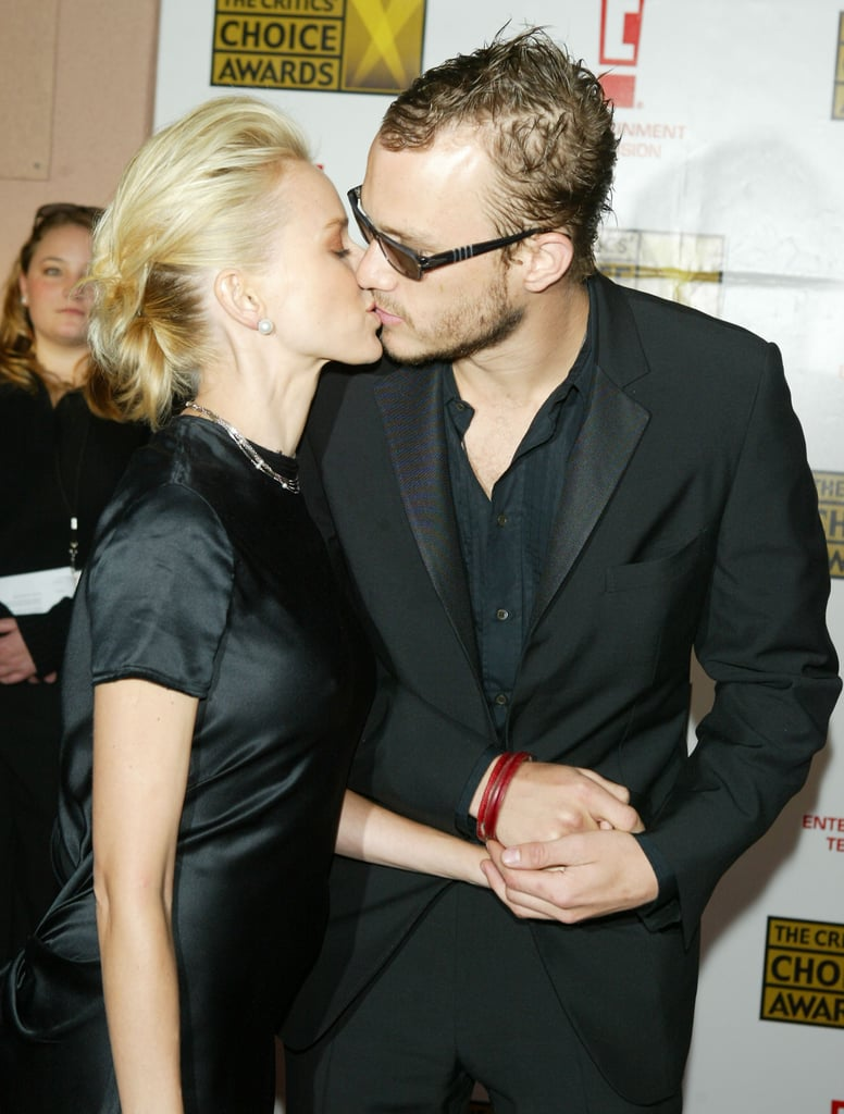 Naomi Watts and then-boyfriend Heath Ledger smooched on the red carpet in 2004.