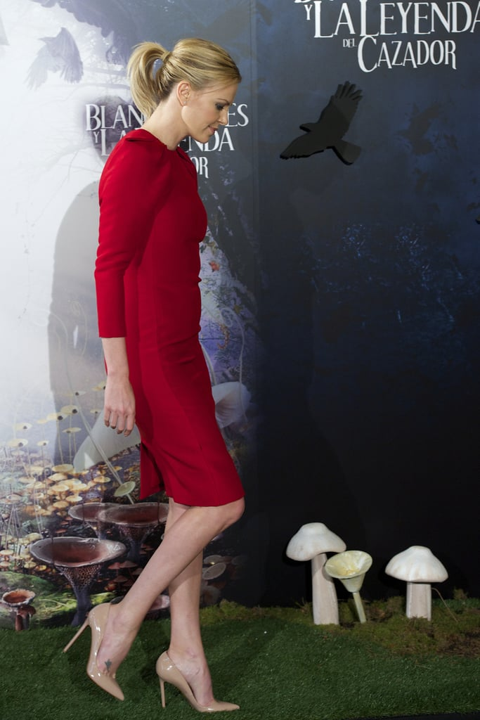 Charlize Theron wore a bright red Giambattista Valli dress for the Snow White and the Huntsman photocall in Madrid.