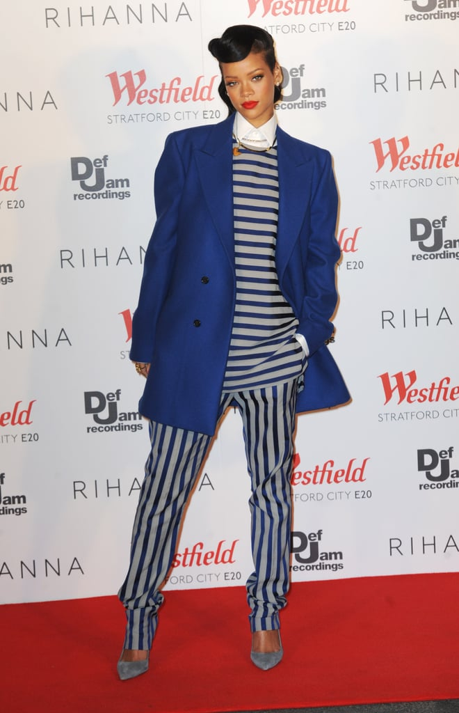 Rihanna donned a blue Raf Simons coat with a striped top and pants from Acne's Spring '12 menswear collection.