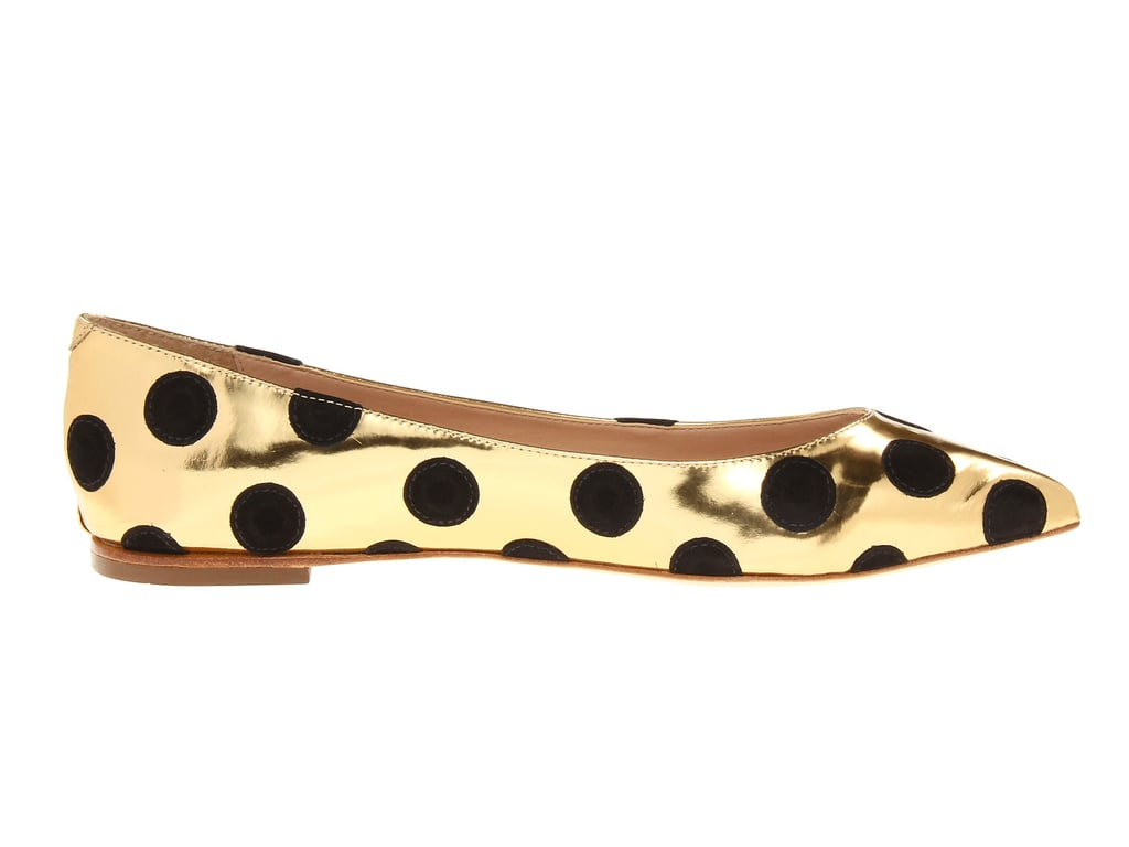 Prepare to be the life of the party in these black and gold polka-dot flats ($295) from Loeffler Randall.