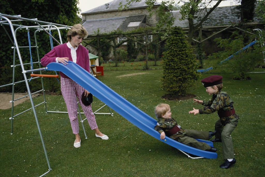 Prince William and Prince Harry played in uniforms in the garden of Highgrove House in Gloucestershire, England, during July 1986 with their mom, Princess Diana.