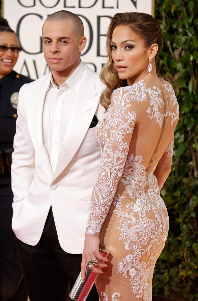 Presenter Jennifer Lopez posed on the Globes red carpet in a lace Zuhair Murad gown on the arm of boyfriend Casper Smart.