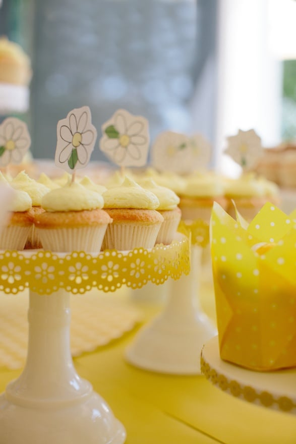 Using the daisy craft punch and some hand drawings, the ordinary white cake stand takes on a more festive feel. Source: Donna Newman Photography