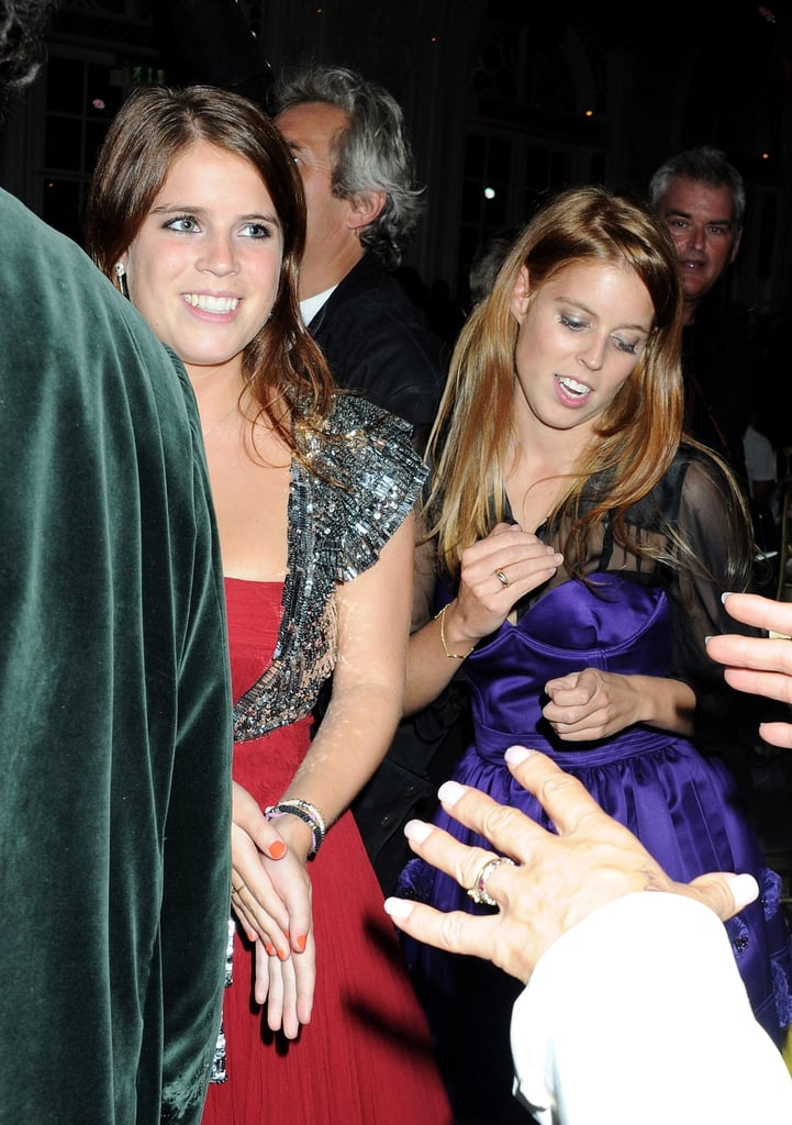 Princess Eugenie and Princess Beatrice dancing.
