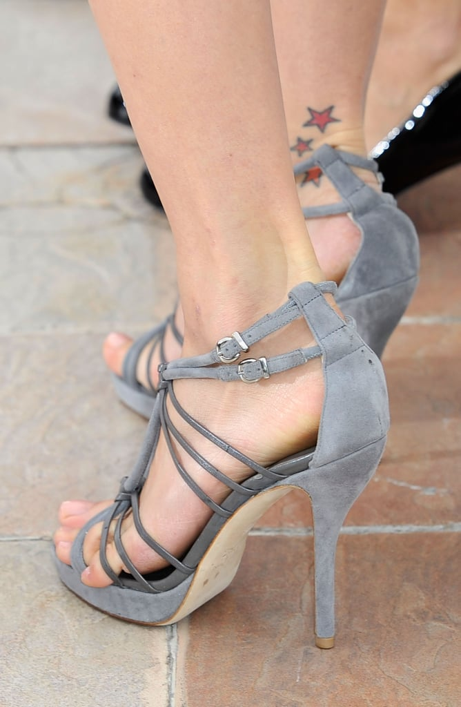 A close-up snap of Petra's gray strappy sandals.