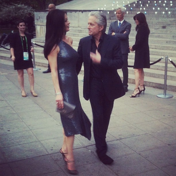 Catherine Zeta-Jones and Michael Douglas stuck together as they made their way into the Vanity Fair party.