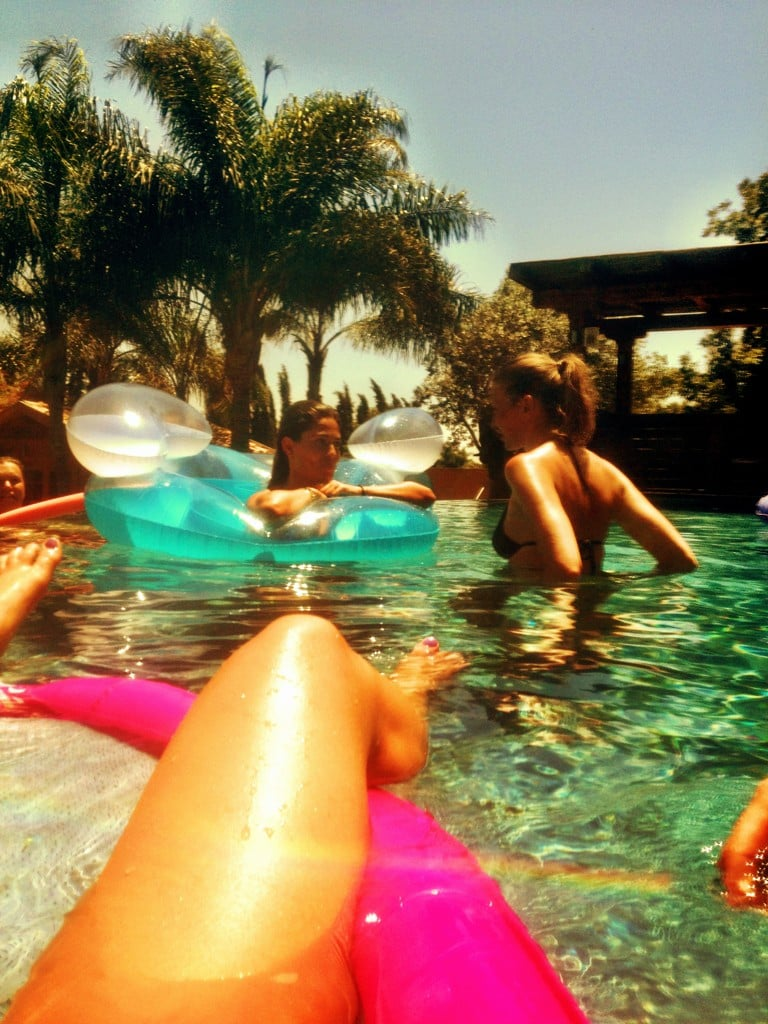 Bar Refaeli hung out in the pool with friends.  Source: Twitter user barrefaeli