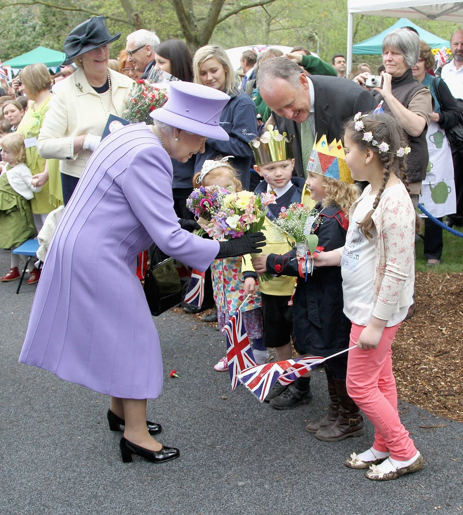 Queen Elizabeth II was given flowers during her visit to Nine Springs Park on May 2.