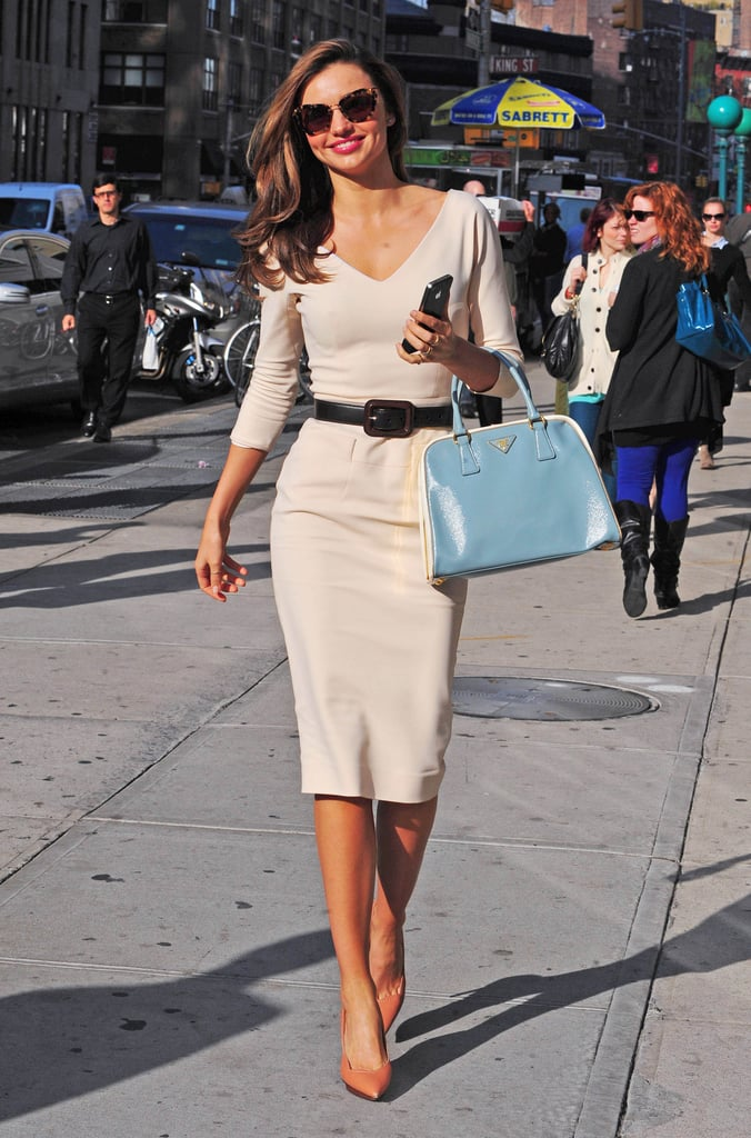 Miranda put a modern spin on classic style — looking glamorous as ever — in a cream-coloured Victoria Beckham dress accessorised with a light blue Prada tote, Lanvin heels, and Miu Miu sunglasses.