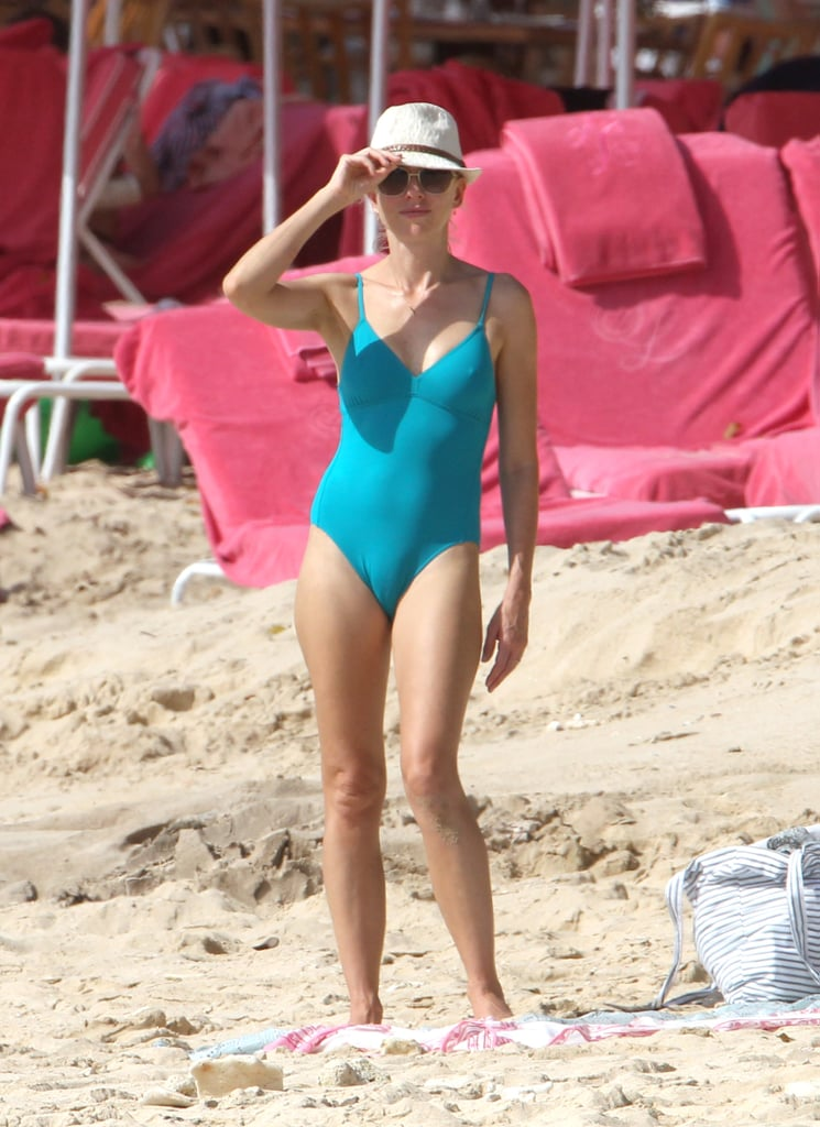 Naomi Watts wore a turquoise suit with a hat on the beach in Barbados.