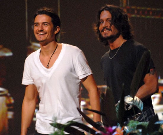 Pirates of the Caribbean co-stars Orlando Bloom and Johnny Depp accepted a colourful surfboard award in 2006.