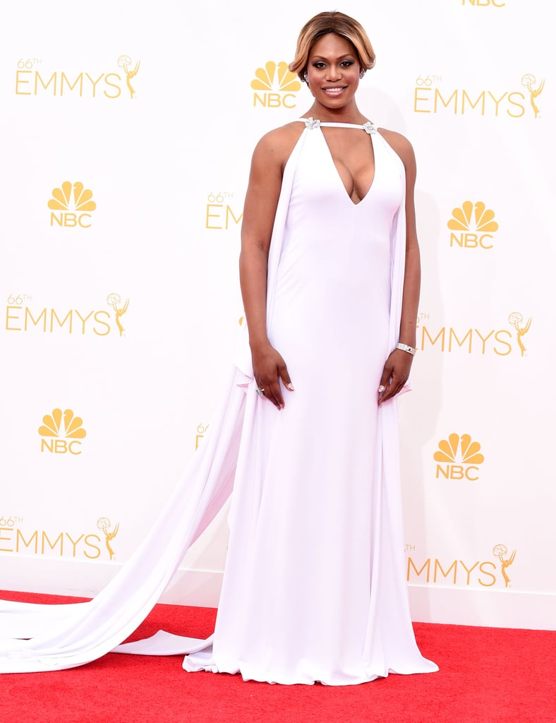 The star rocked a revealing neckline in a stunning white Marc Bouwer gown at the 2014 Emmys.