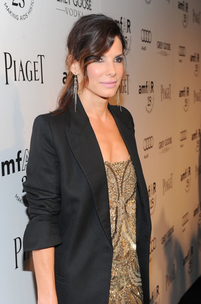 Sandra Bullock put her hair up for the event.