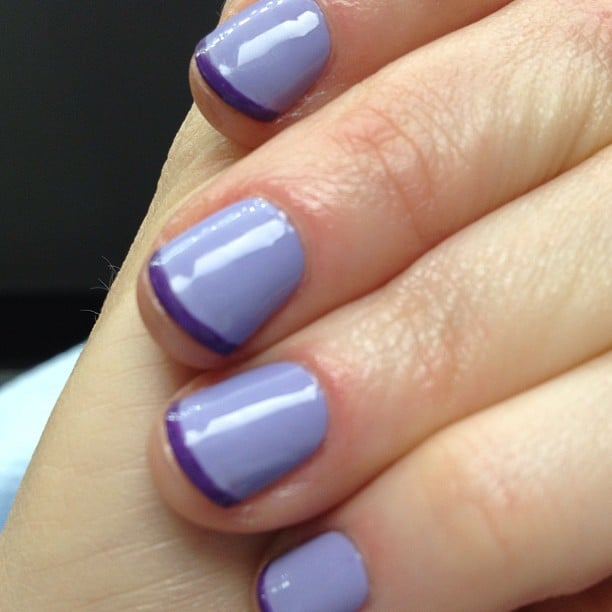 Nail diva Zooey Deschanel opted for a purple-on-purple French manicure this week. Source: Instagram user zooeydeschanel
