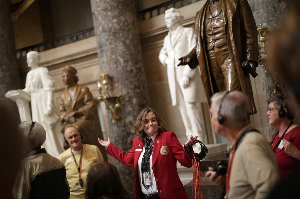 A US Capitol tour guide conducted a tour after being put back to work.