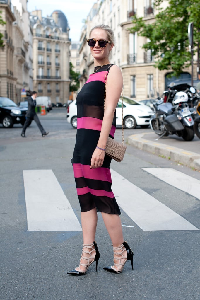 There about a million ways to wear stripes, but we love the sophisticated shape they take on this sheath in standout black and pink.