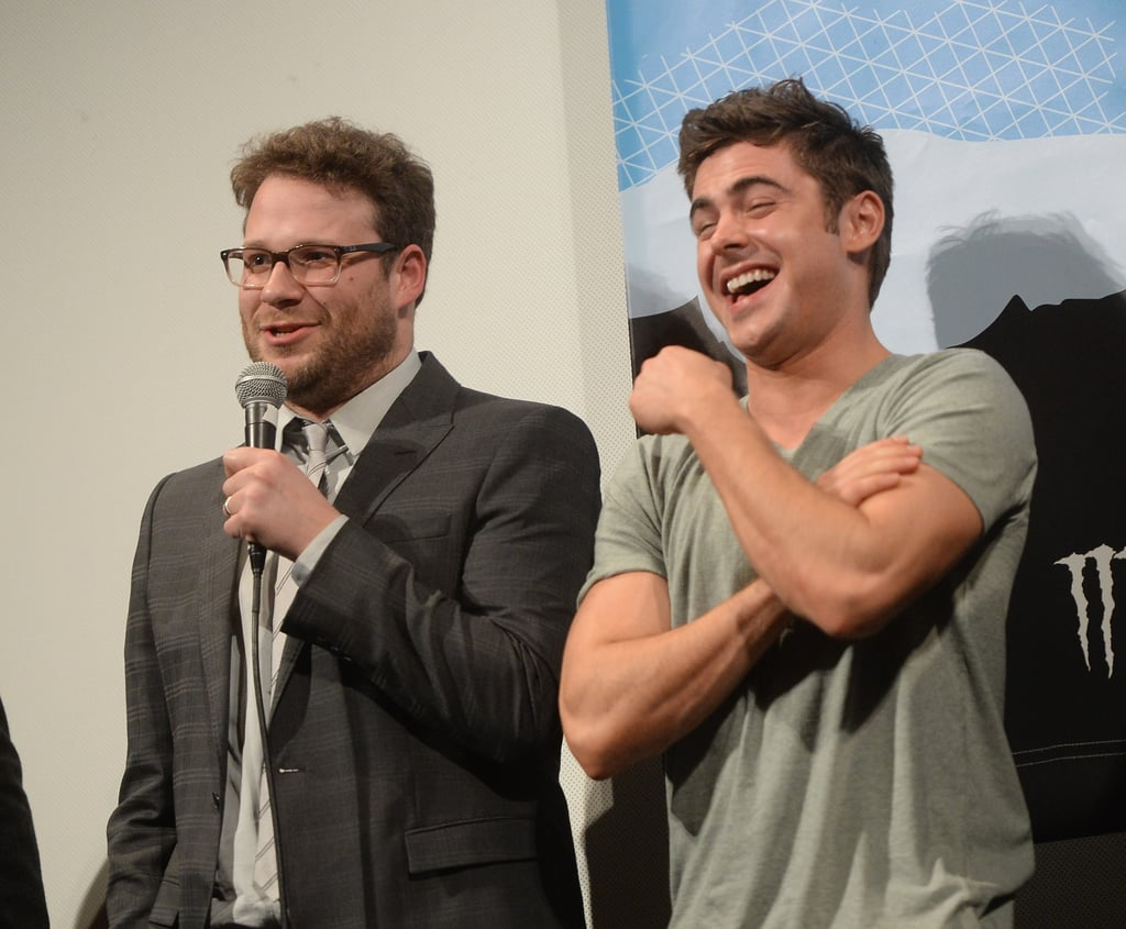 Someone said something to make Zac Efron burst out in laughter next to Seth Rogen on Saturday.
