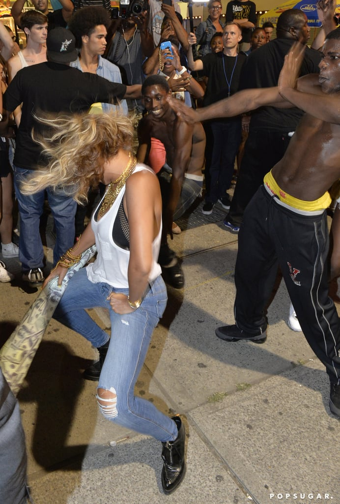 """All eyes were on Beyoncé as she danced with fans while shooting the video for """"XO"""" at Coney Island in August 2013."""