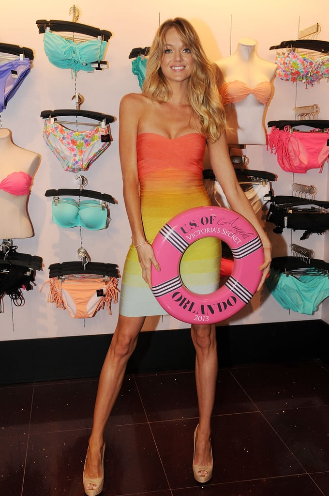 Victoria's Secret model Lindsay Ellingson revealed her fit figure in a rainbow-hued body-con dress at the Angels Swim Summer tour in Orlando.