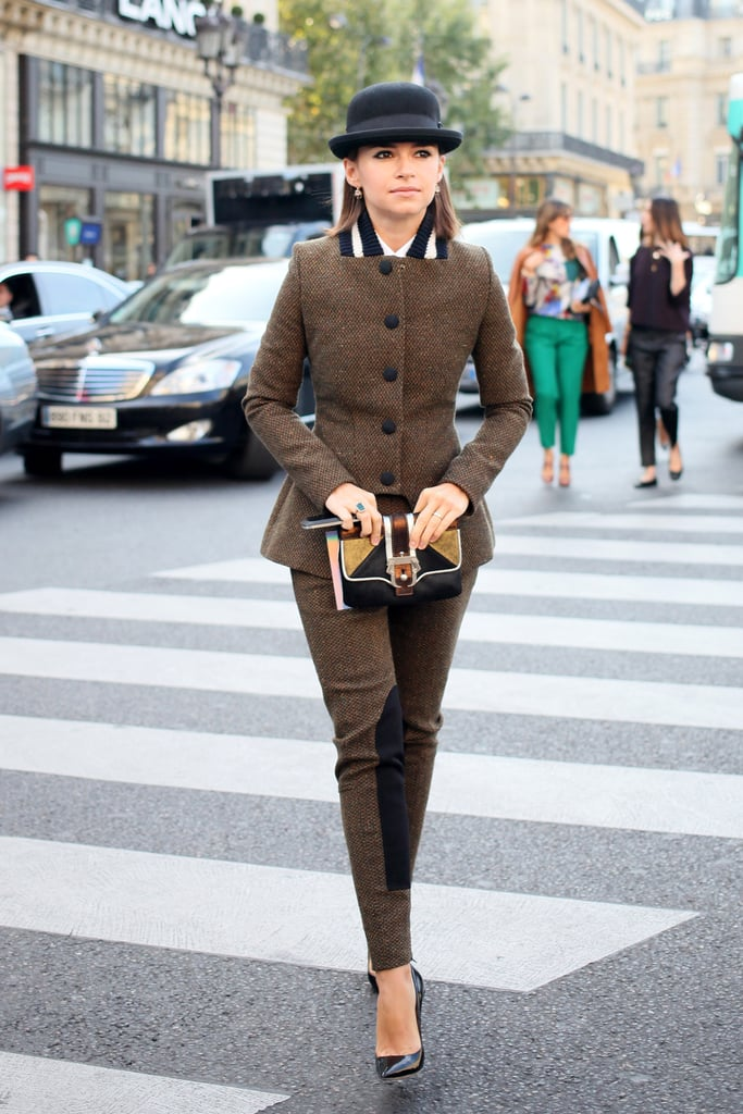 Miroslava Duma switched gears in a buttoned-up tweed suit and a bowler hat.
