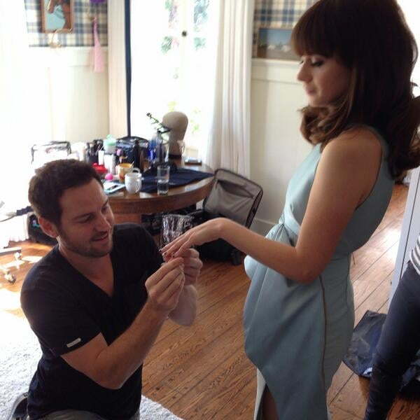 What an adorable photo of manicurist Tom Bachik touching up Zooey Deschanel's nails before the red carpet. Source: Twitter user redcarpetman