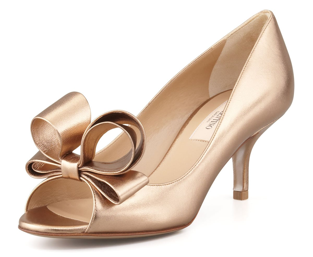 Valentino gold bow open-toe heels ($695)